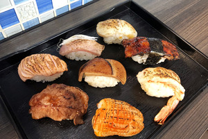 到深水埗掃街的朋友可試試「炙壽司」,主打火炙壽司,有火炙三文魚壽司、火炙吞拿魚等選擇,價錢實惠。