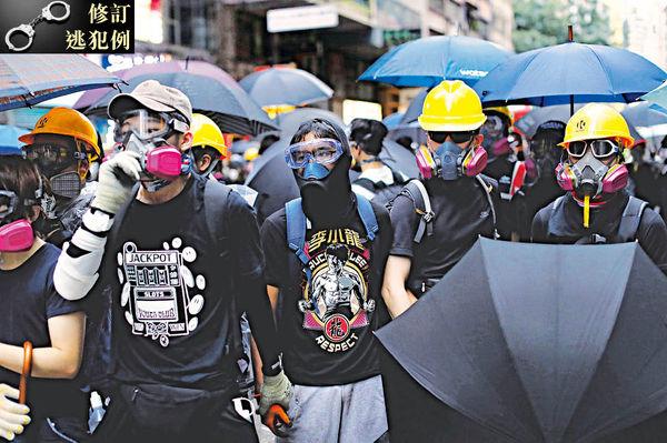 禁蒙面法違憲 警方暫緩執行 「危害公安」下引緊急法 違基本法