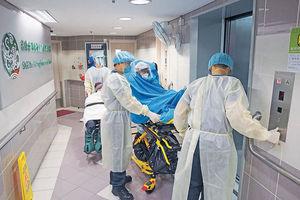 病患除罩食藥 傳染診斷中心2職員 石榮樓累計4戶爆疫 踩強檢綫